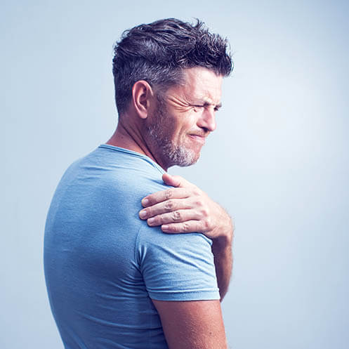 Man with grey hair and back pain